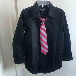 Boys black dress shirt worn tie